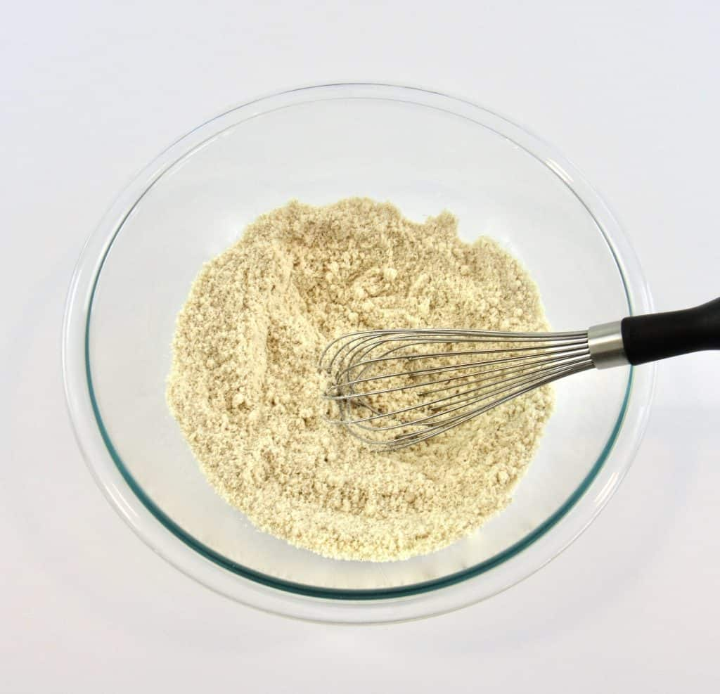 banana bread dry ingredients in glass bowl with whisk