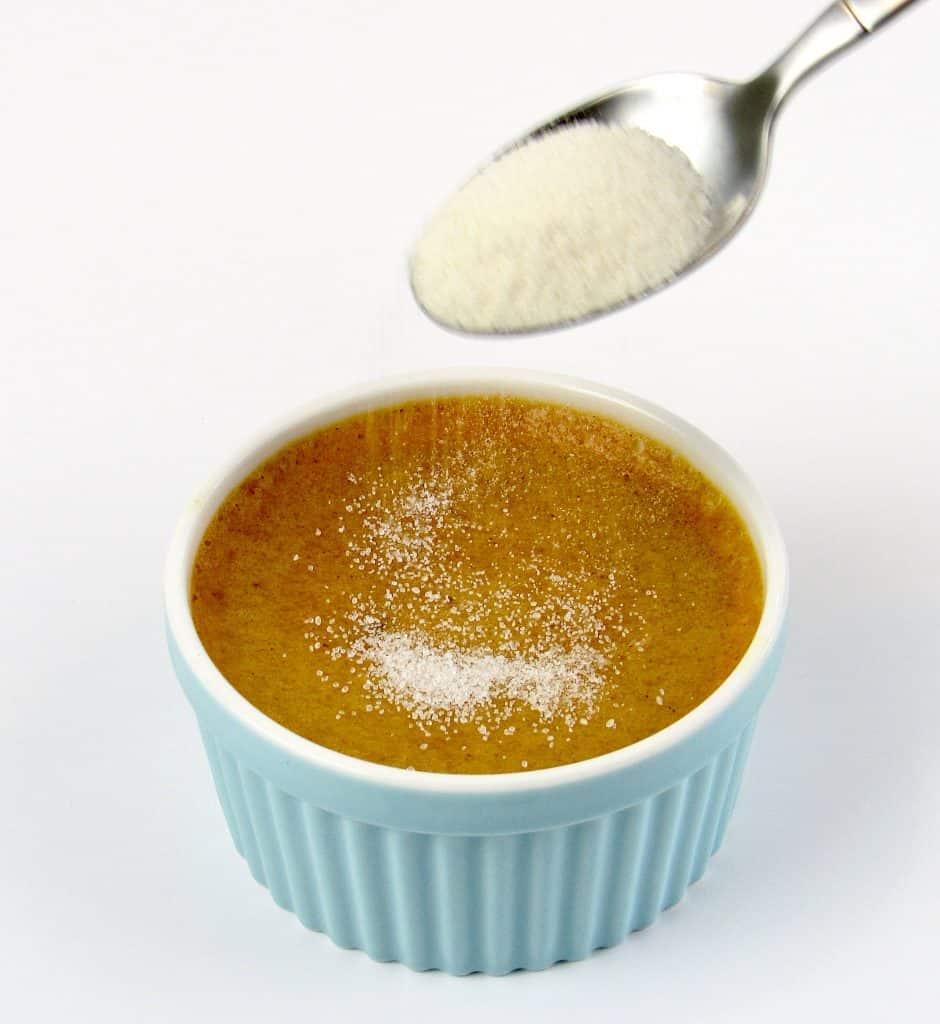 sugar being spooned over creme Brûlée