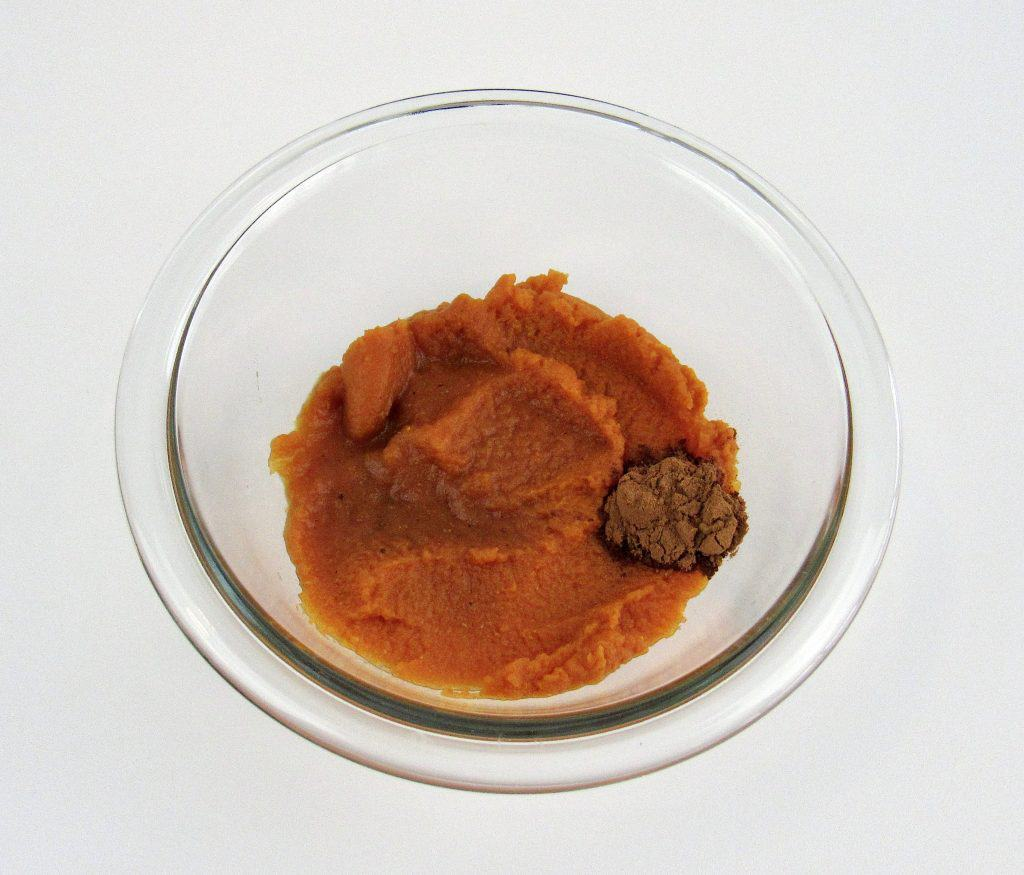 glass bowl with pumpkin puree and spice