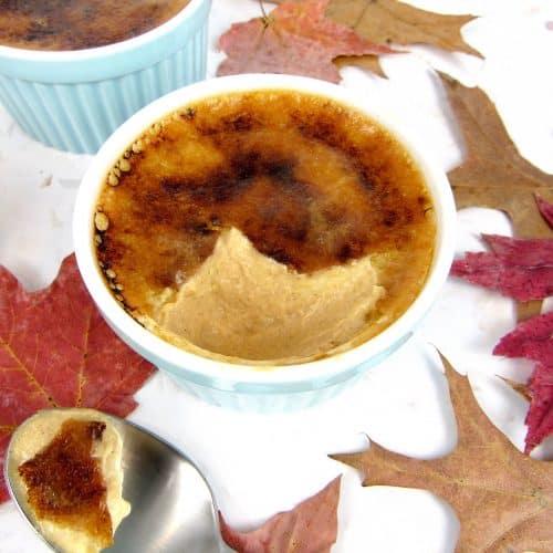 pumpkin creme Brûlée in a ramekin with spoonful on side