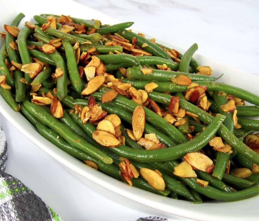 green beans with almonds in white bowl