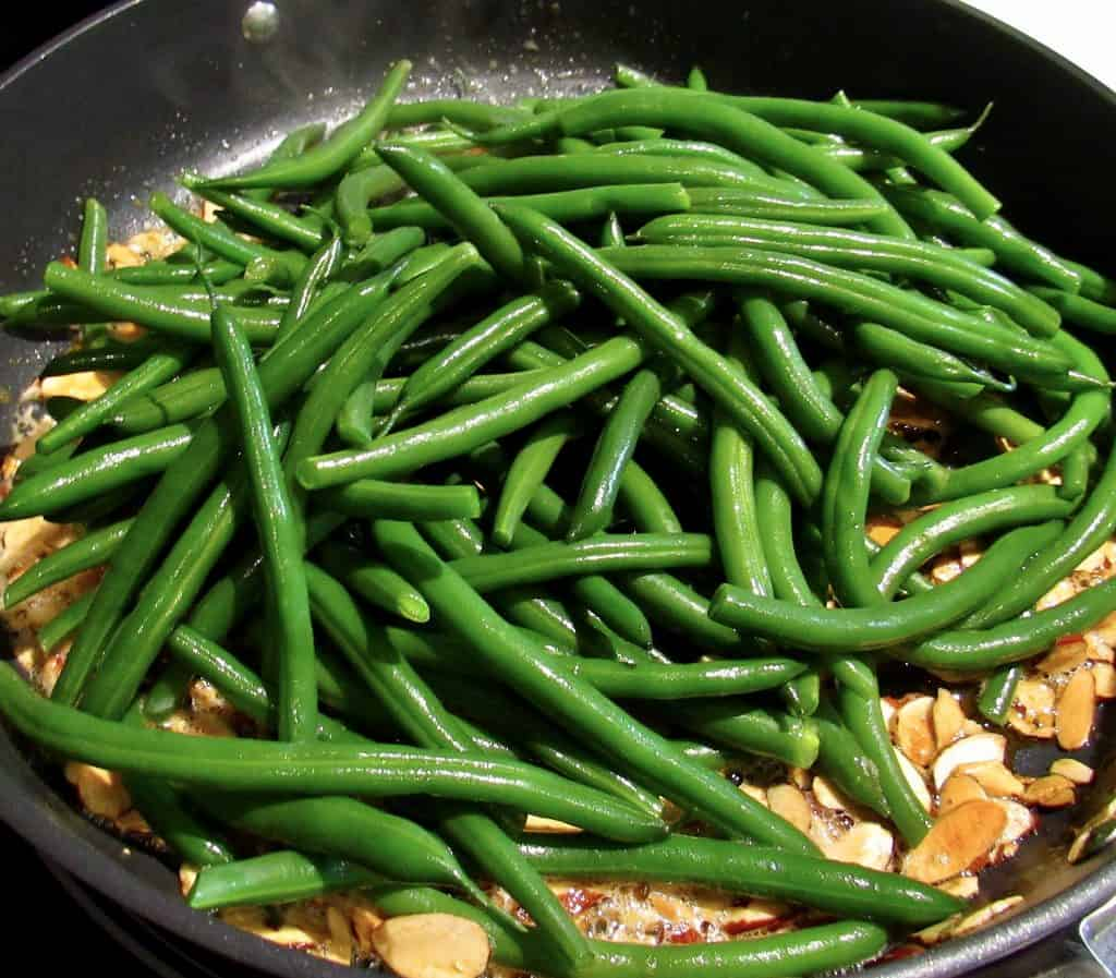green beans in skillet with toasted almonds