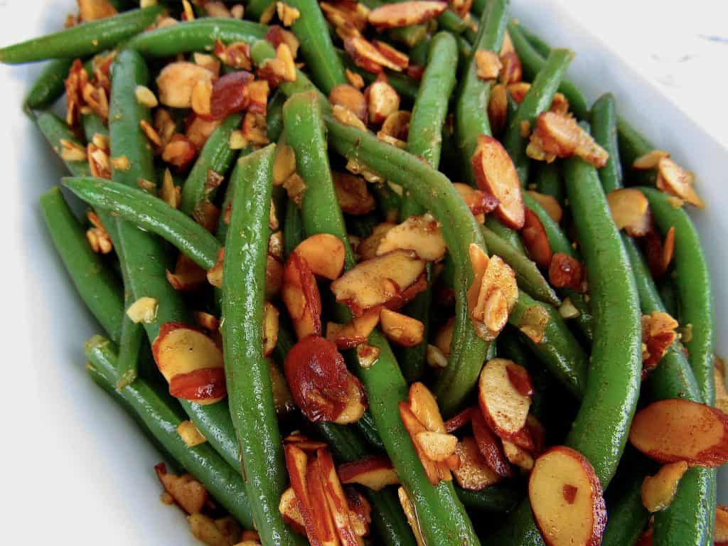 overhead closeup of green beans with almonds