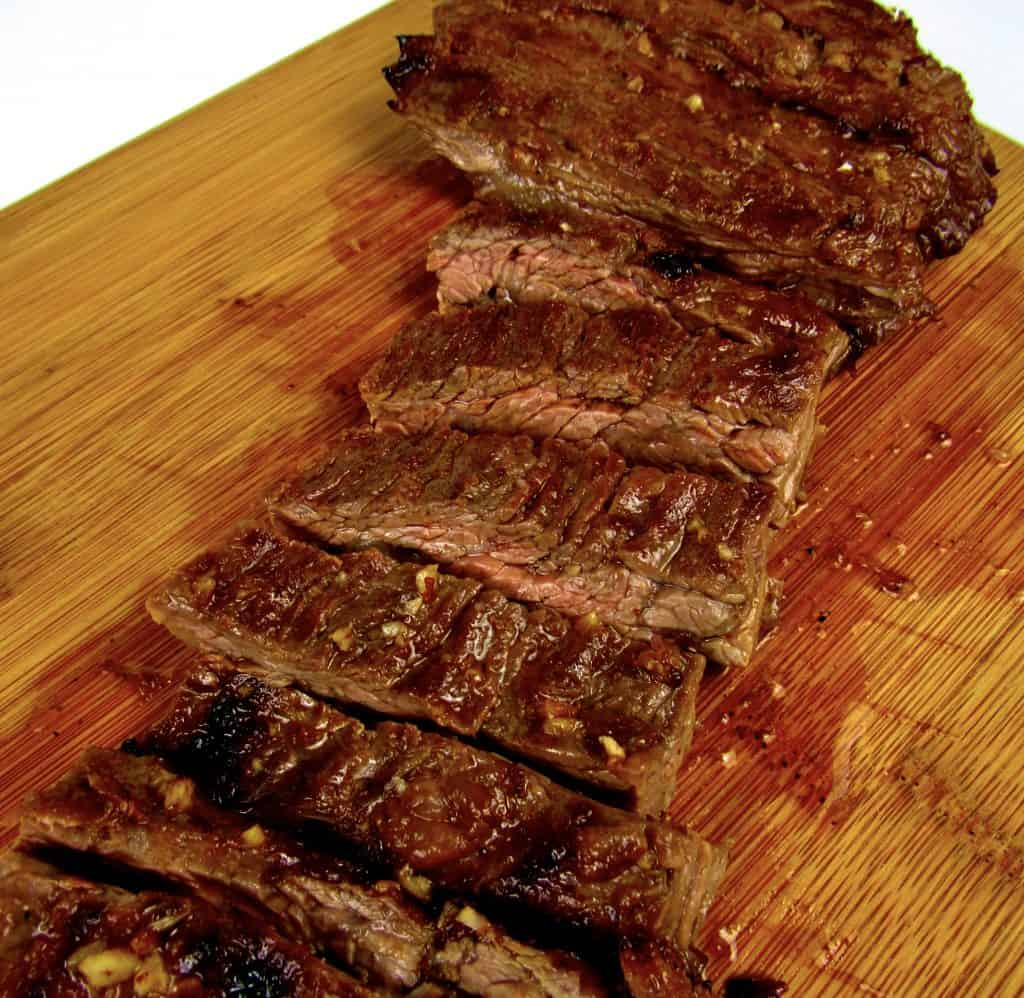 shirt steak on cutting board sliced up