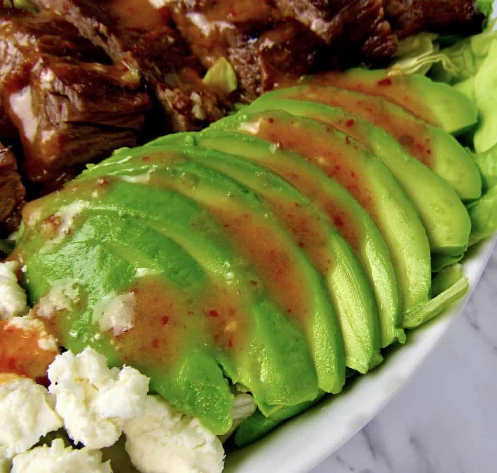 closeup of sliced avocado on salad