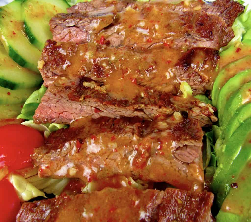 grilled steak with dressing over the top