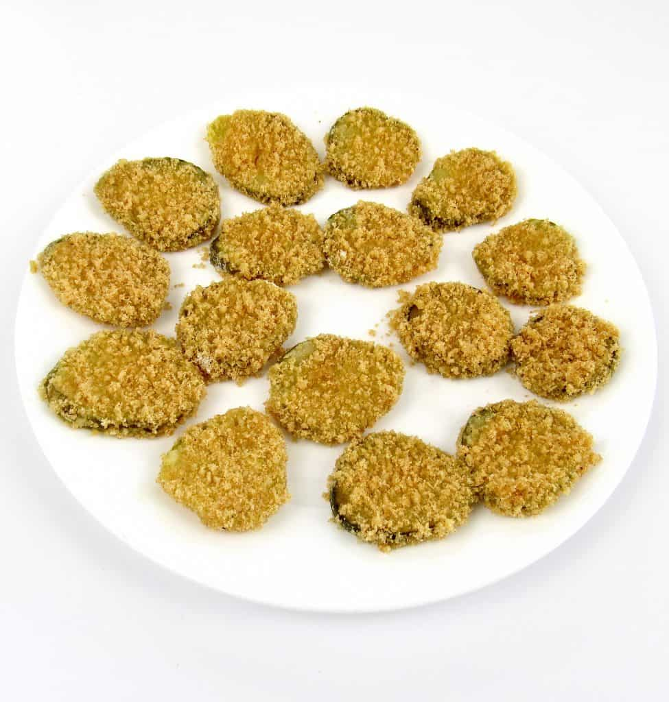 breaded pickles on white plate