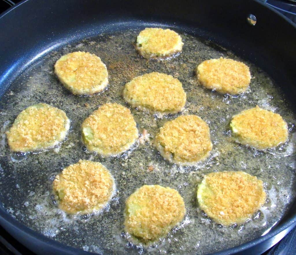 pickle slices frying in skillet