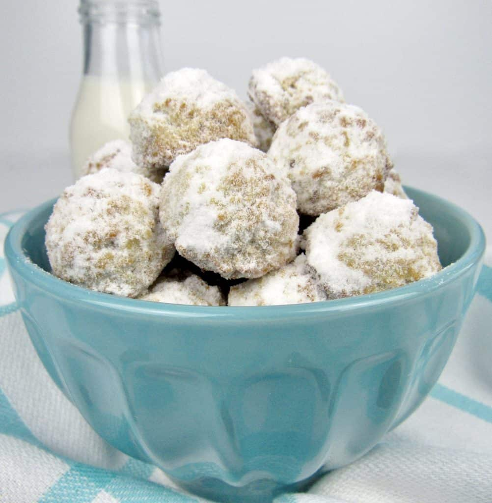 closeup of snowball cookies in blue bowl