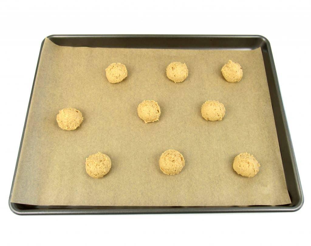 pumpkin whoopie pies dough balls on sheet pan