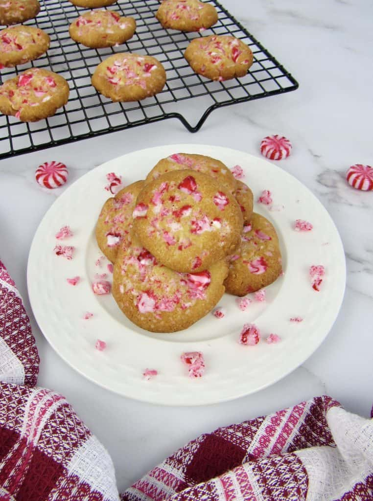 White Chocolate Peppermint Cookies on plate and baking rack