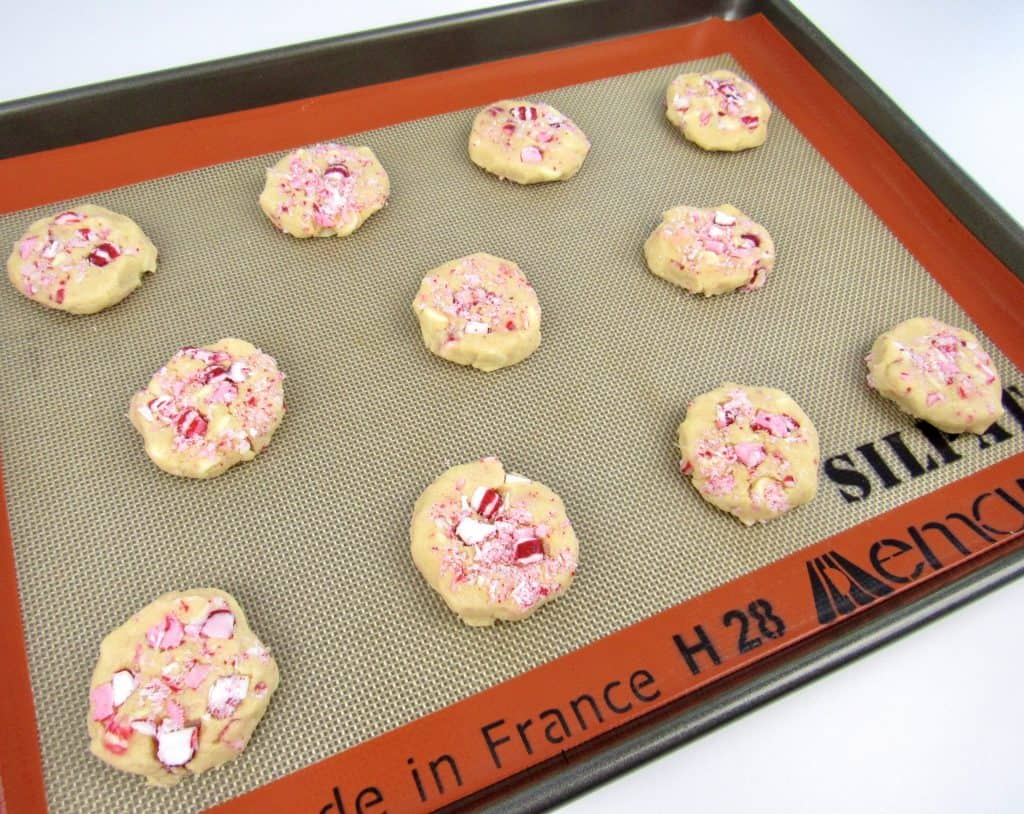 white chocolate peppermint cookies unbaked on baking sheet