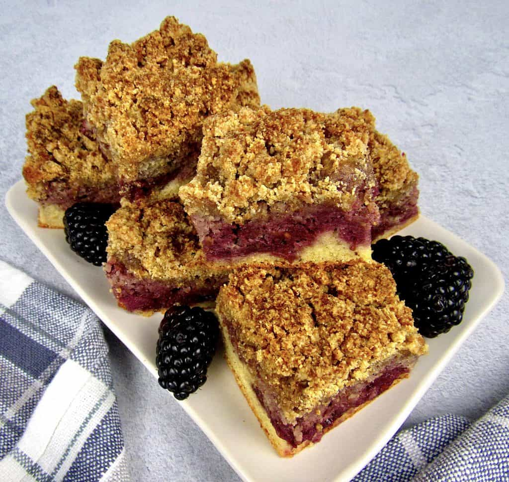 overhead view of pieces of blackberry coffee cake stacked on plate