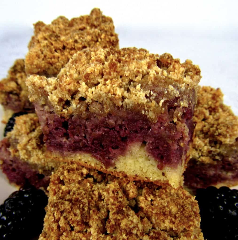 closeup of pieces of blackberry coffee cake stacked on plate