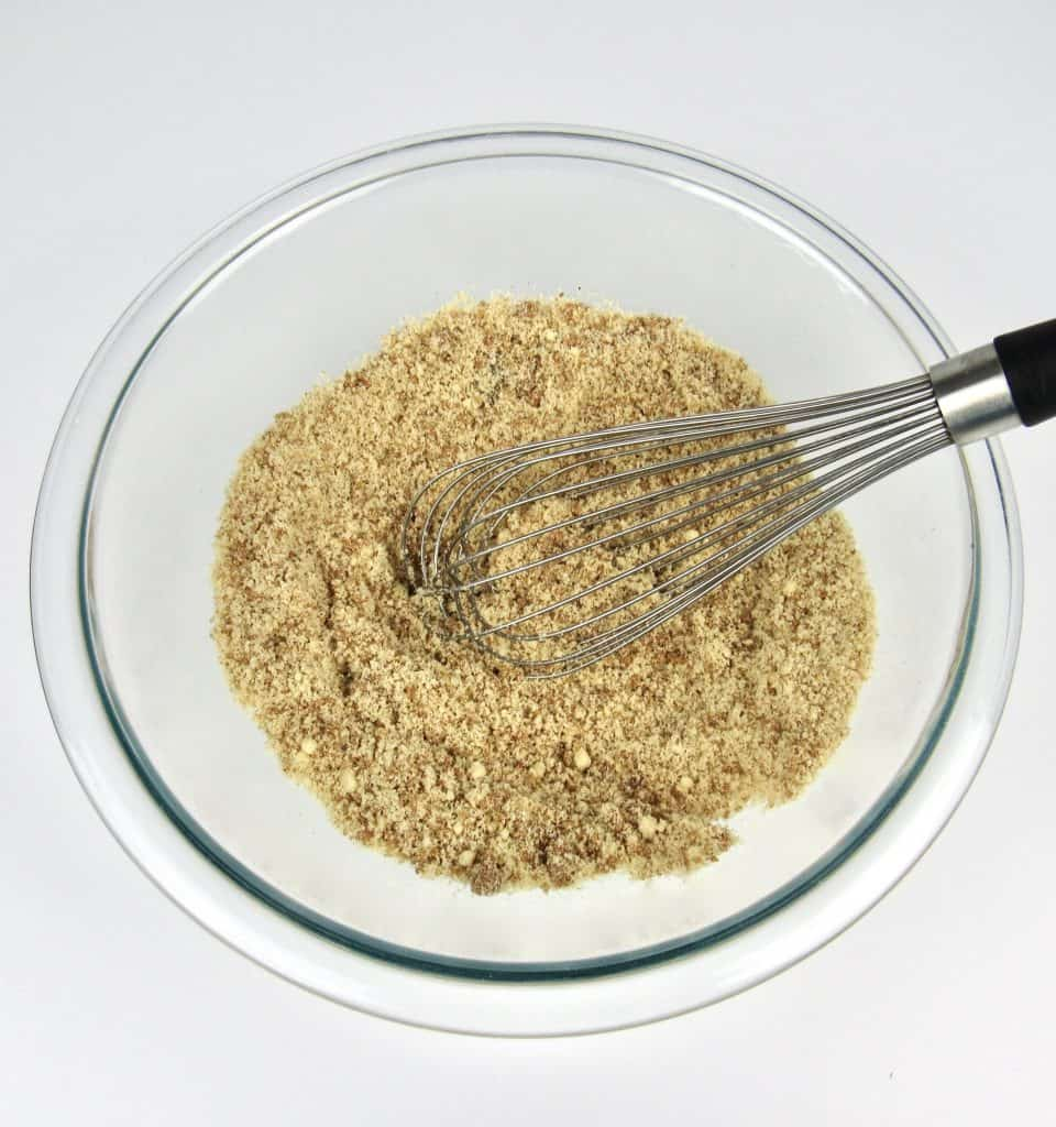 crumble topping ingredients in bowl with whisk