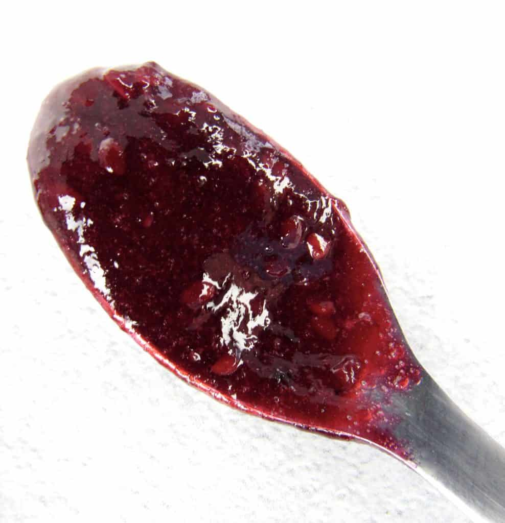 closeup of blackberry jam on spoon