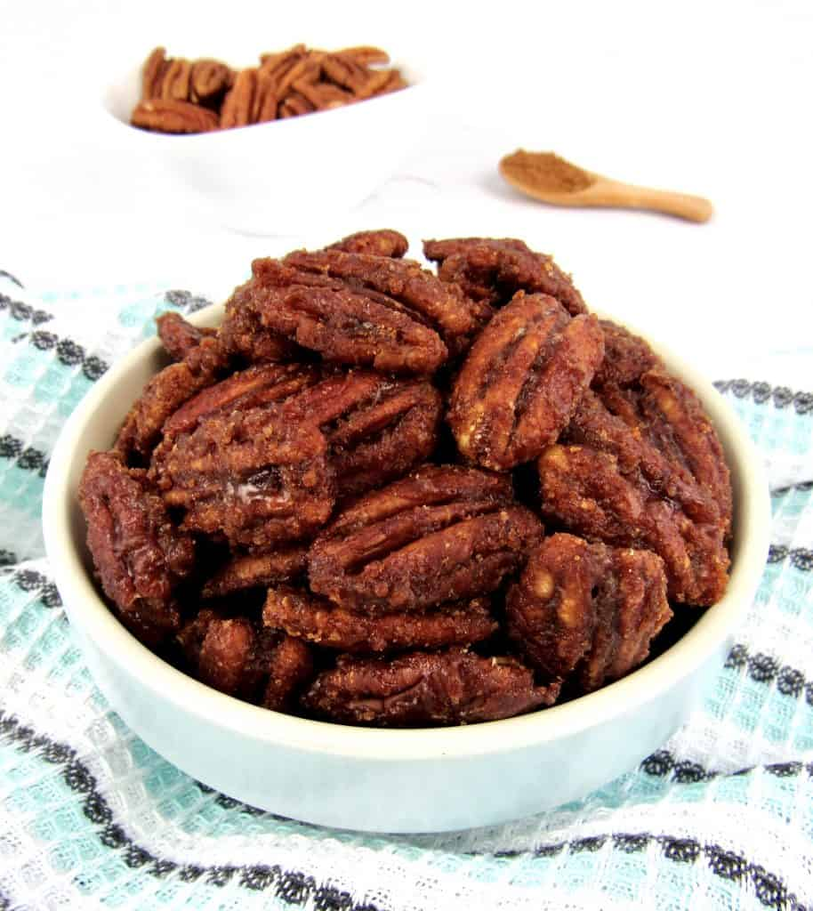 candied pecans in blue bowl