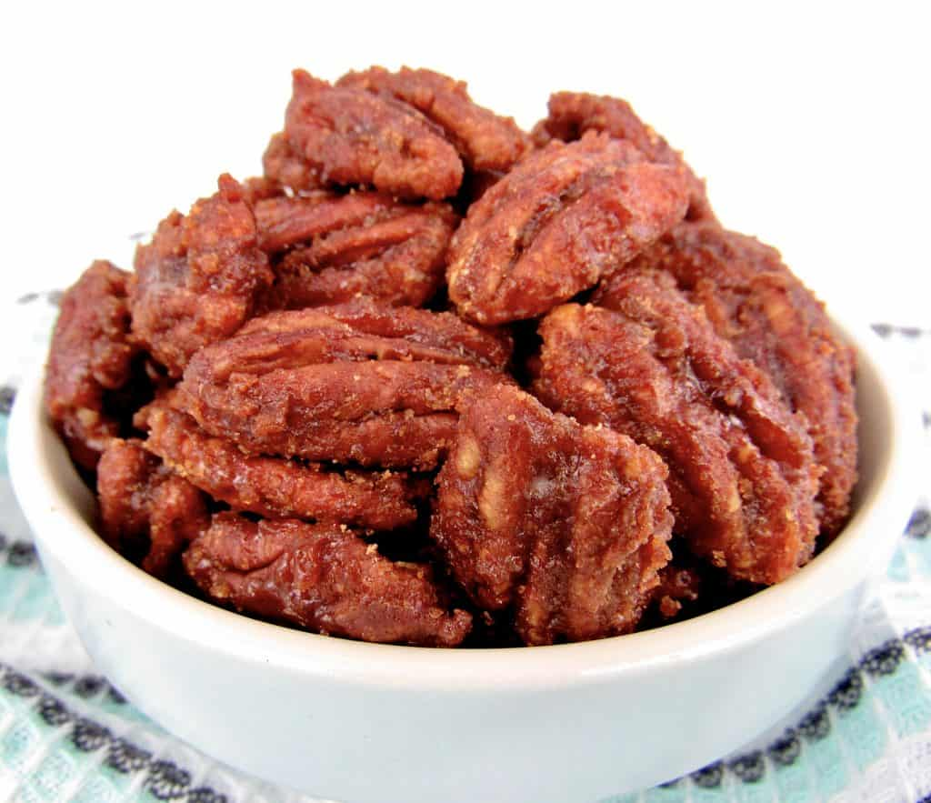 closeup of candied pecans in blue bowl