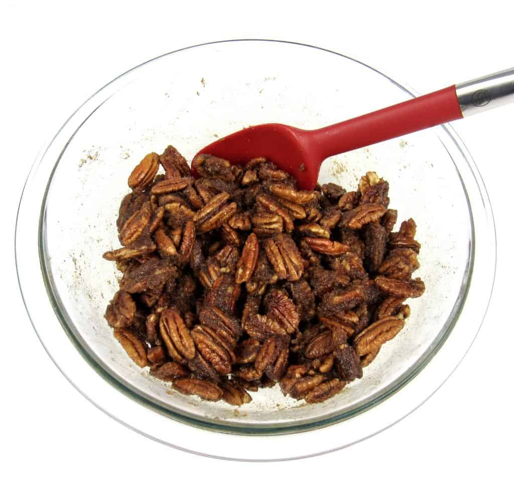 candied pecans mixture in glass bowl