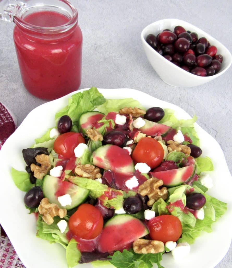 cranberry dressing poured over salad