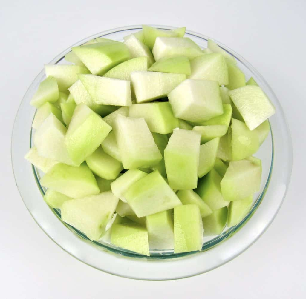 diced chayote squash in glass bowl