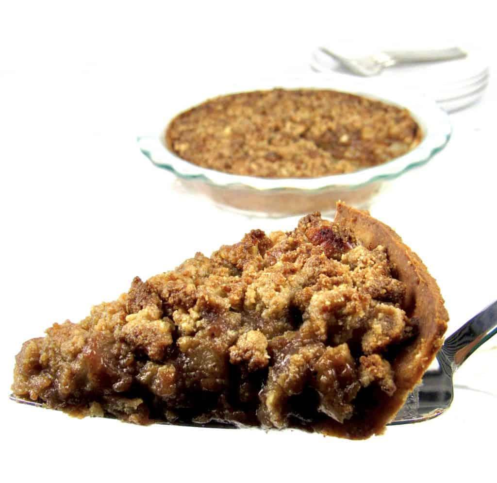closeup of slice of dutch apple pie being held up