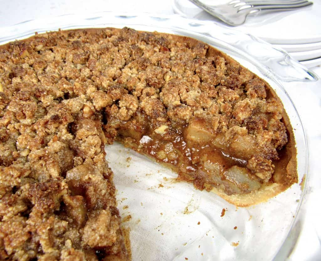 dutch apple pie with slice taken out