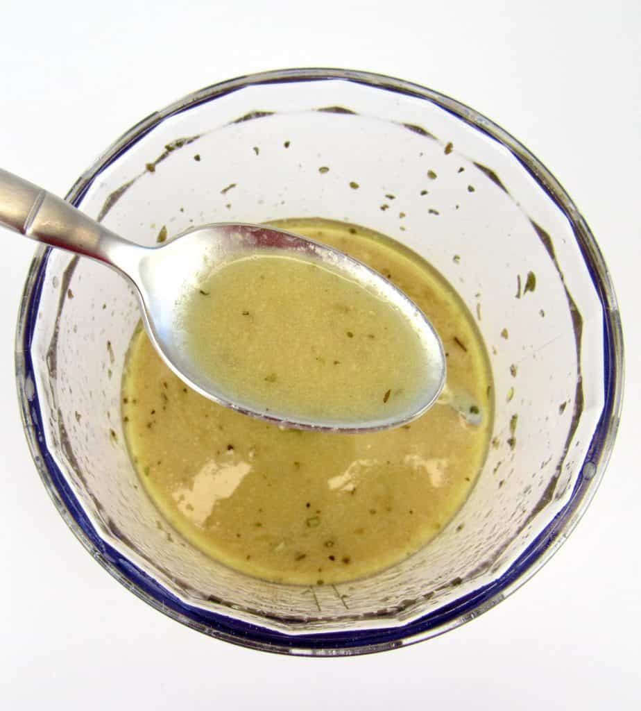 salad dressing in mini chopper bowl with spoonful