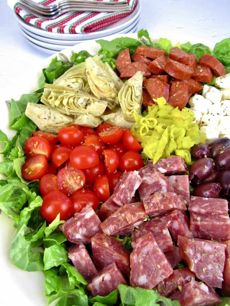 closeup of antipasto salad in white bowl
