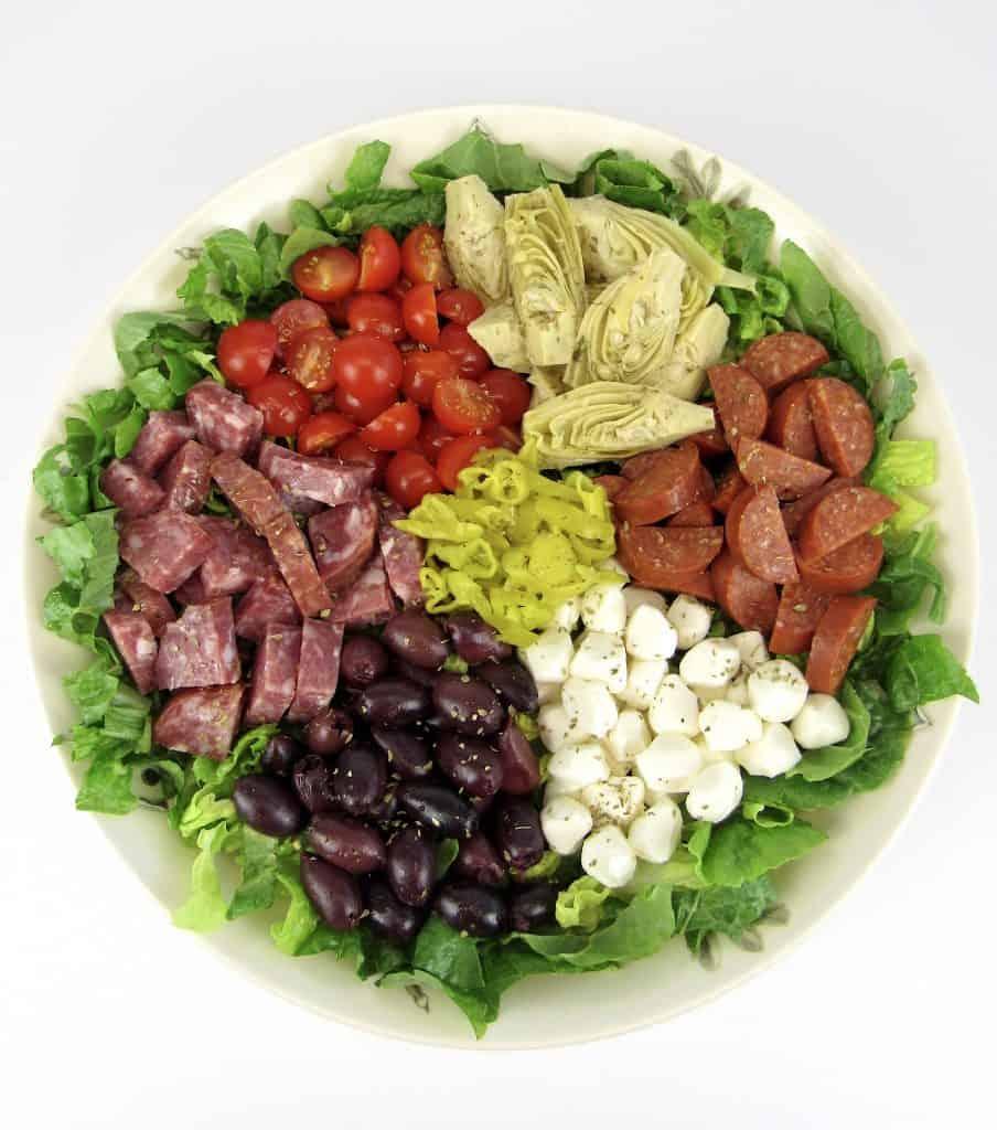 antipasto salad in white bowl