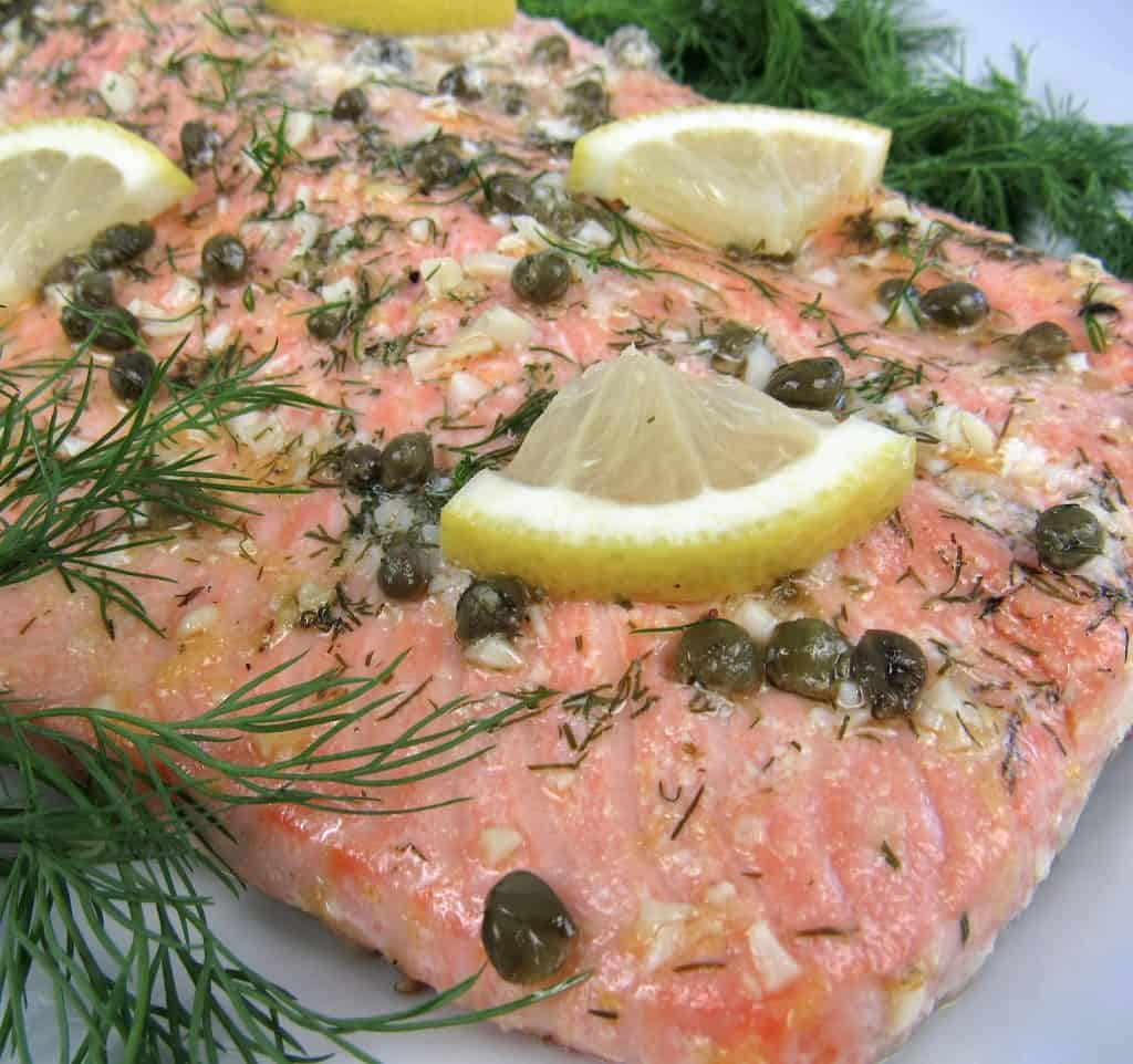 closeup of Baked Salmon in Foil with herbs on top