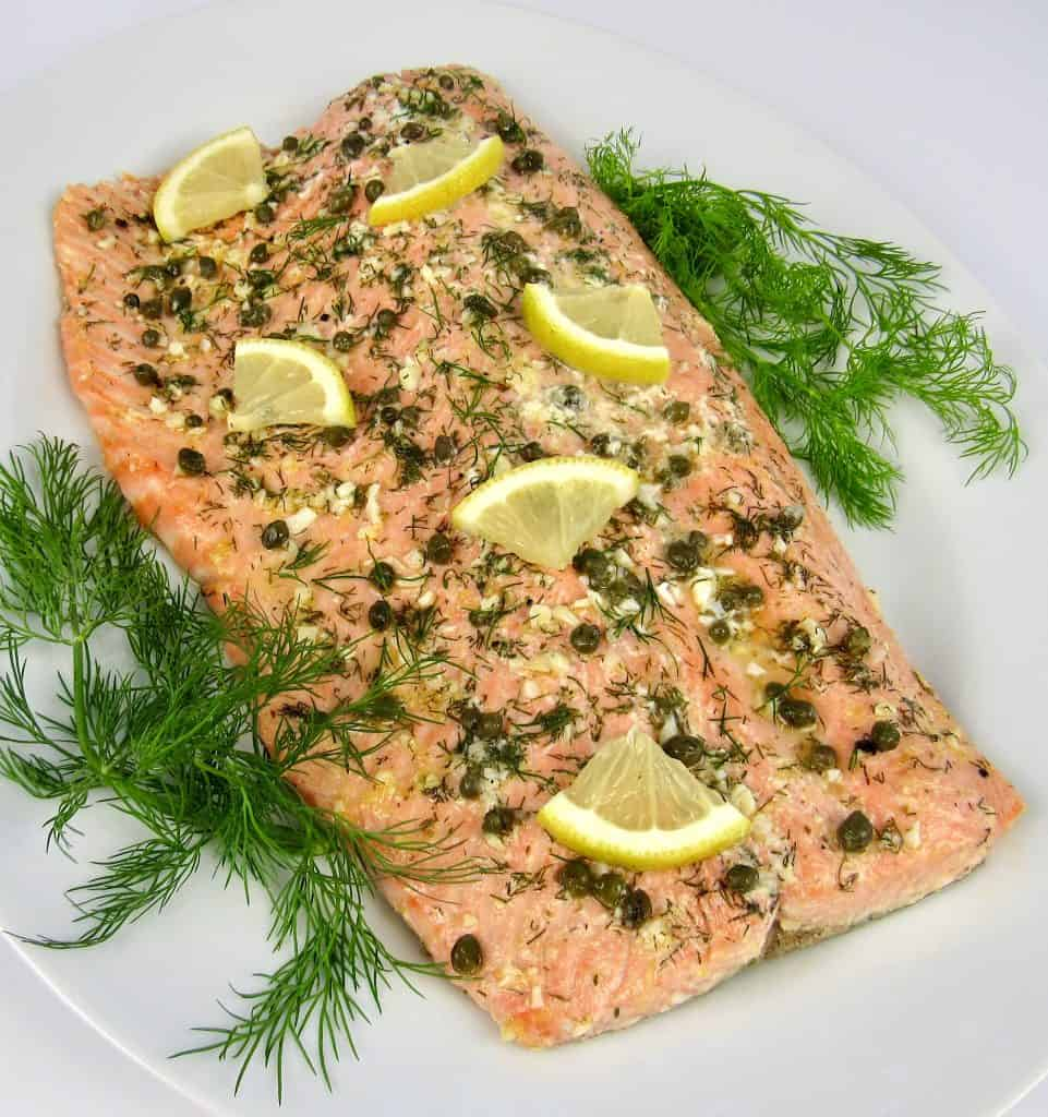Baked Salmon in Foil with herbs on top and dill on side