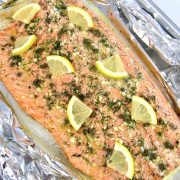 Baked Salmon in Foil with slices of lemon on top