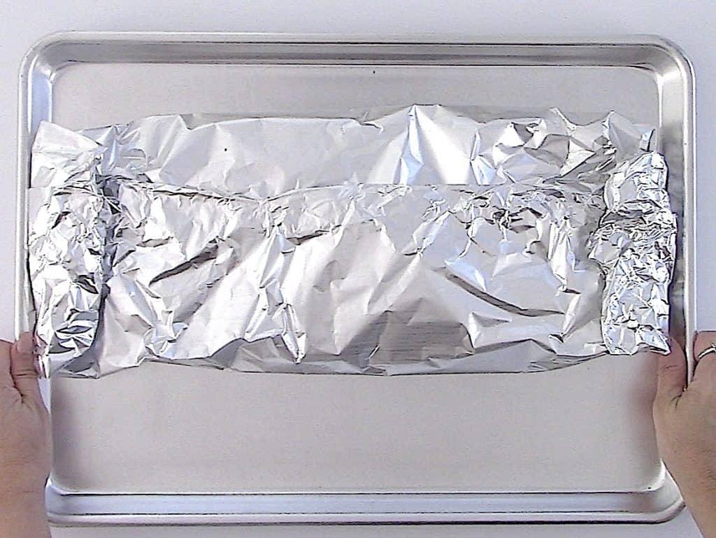 salmon in foil on sheet pan