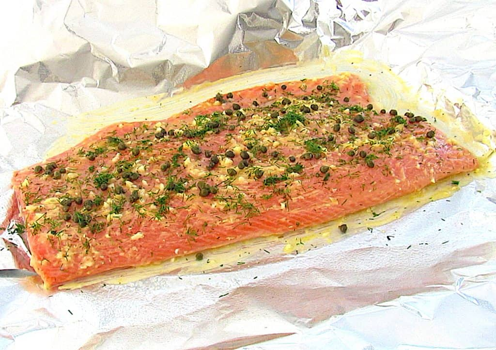 salmon with butter dill and garlic on foil