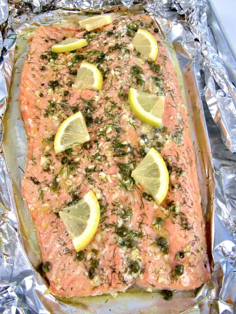 Baked Salmon in Foil with herbs and slices of lemon on top