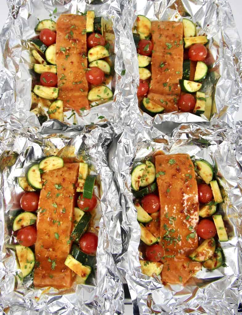 overhead view of salmon and veggies in foil baked