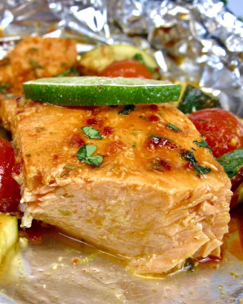 closeup of salmon and veggies in foil baked
