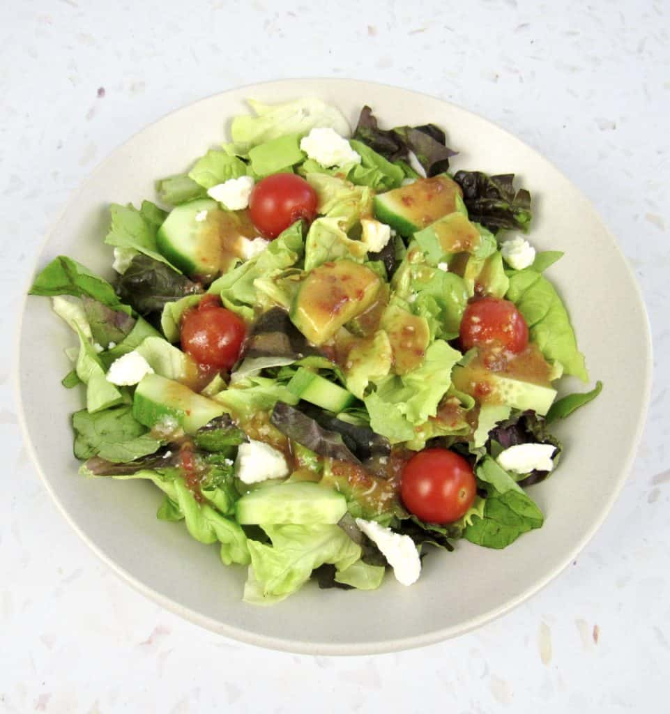 overhead view of salad with chipotle lime vinaigrette on top