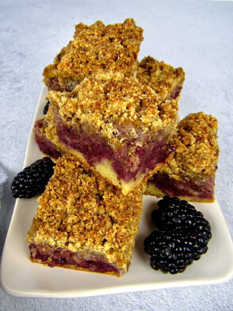 pieces of blackberry coffee cake stacked on plate