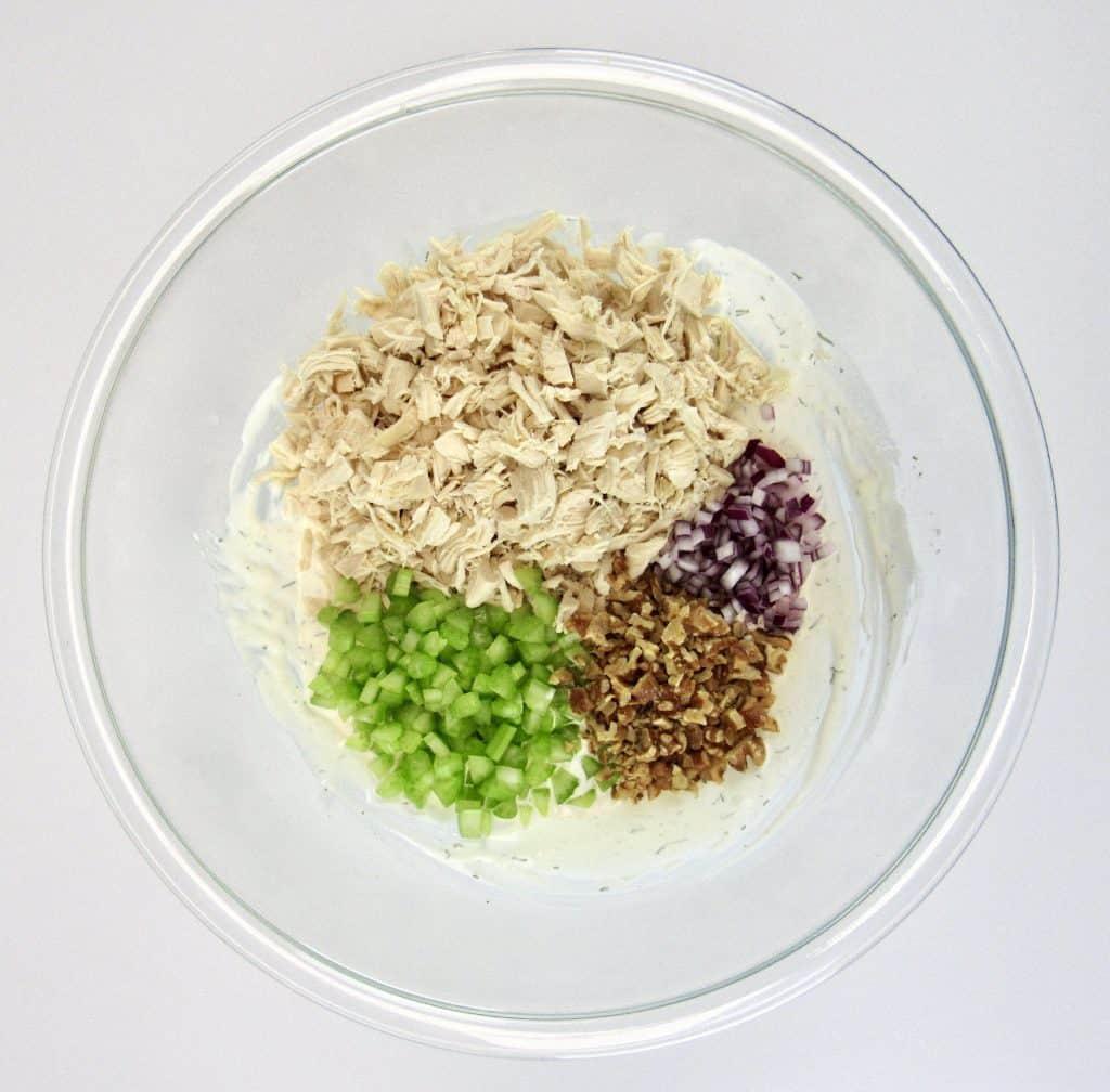 chicken salad ingredients in glass bowl unmixed