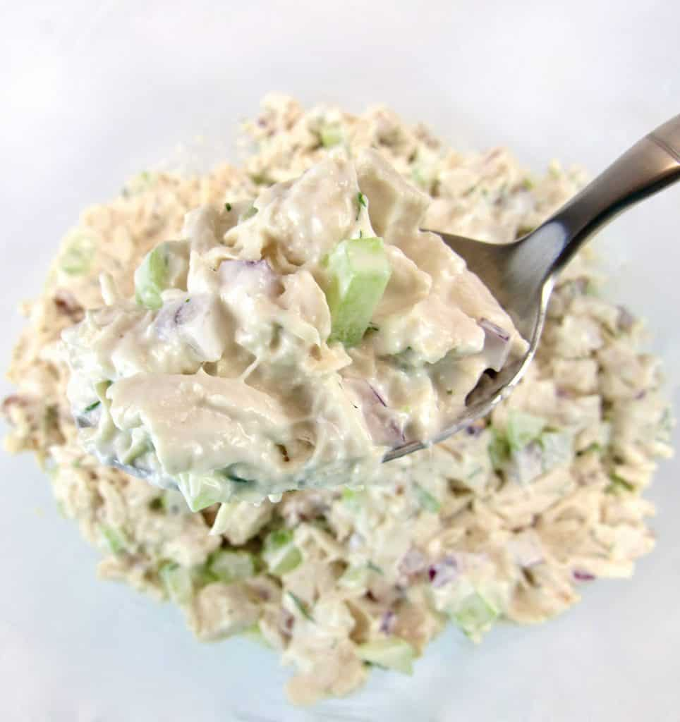 chicken salad in bowl with spoonful