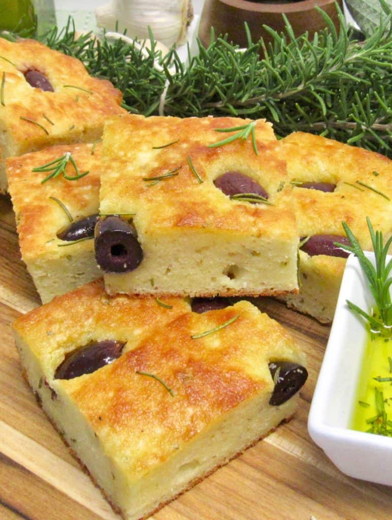 rosemary focaccia stacked on cutting board