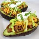 closeup of Taco Stuffed Avocados on white plate