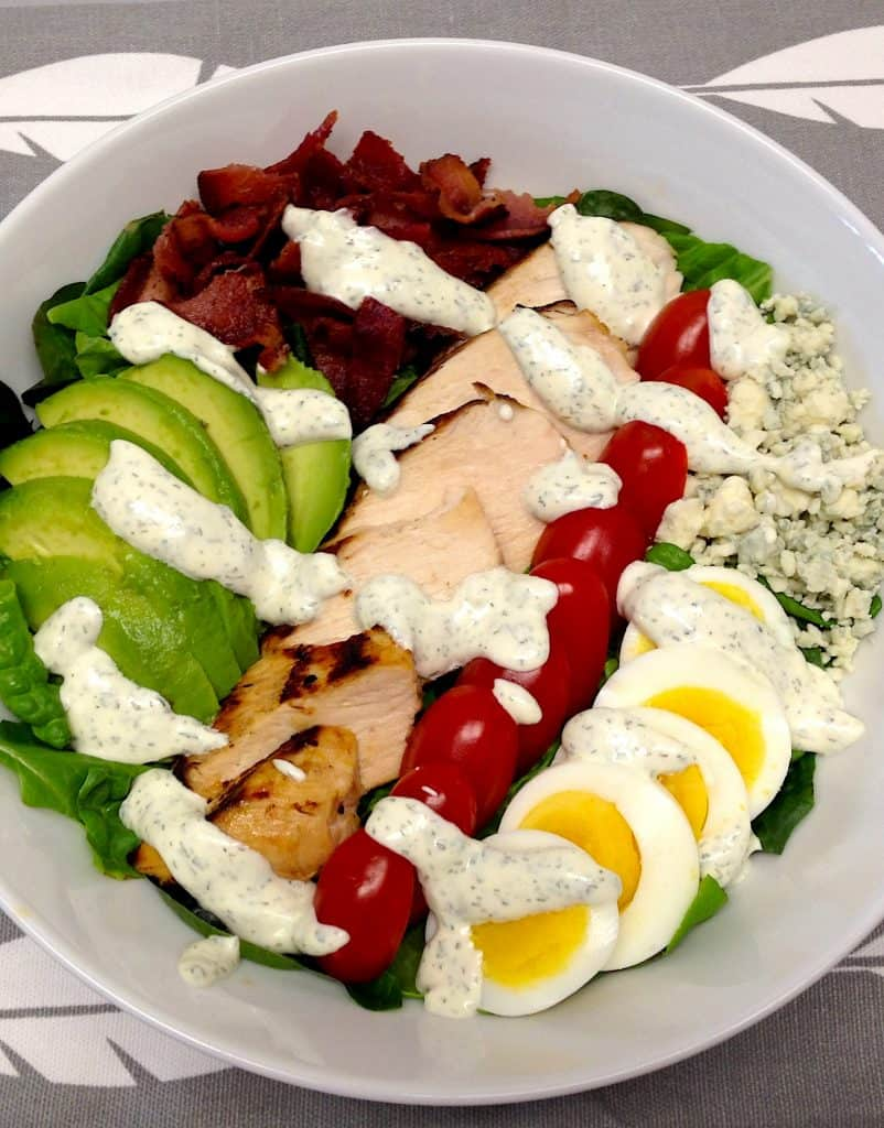 cobb salad with ranch drizzled on top