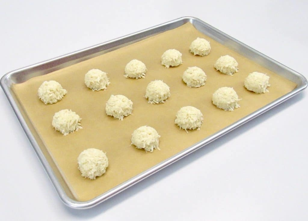 coconut macaroons on baking sheet unbaked