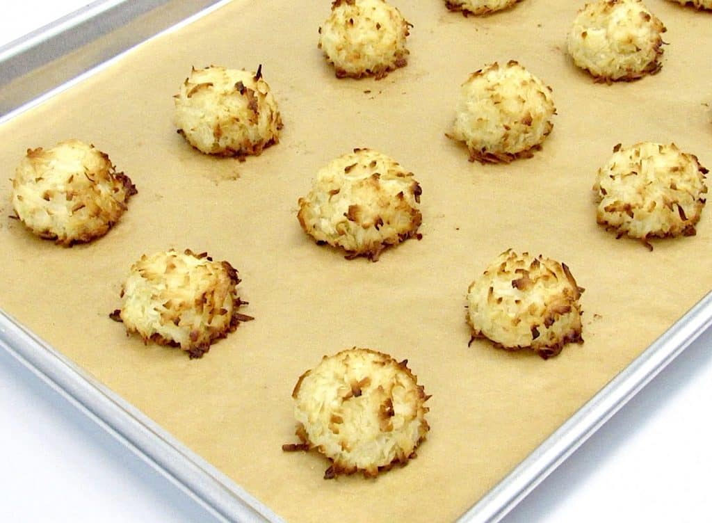 coconut macaroons on baking sheet baked
