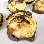 coconut macaroons with chocolate drizzled on top