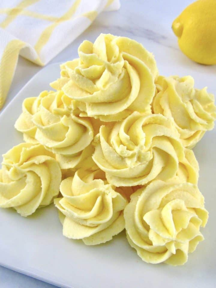 lemon fat bombs stacked up on white plate
