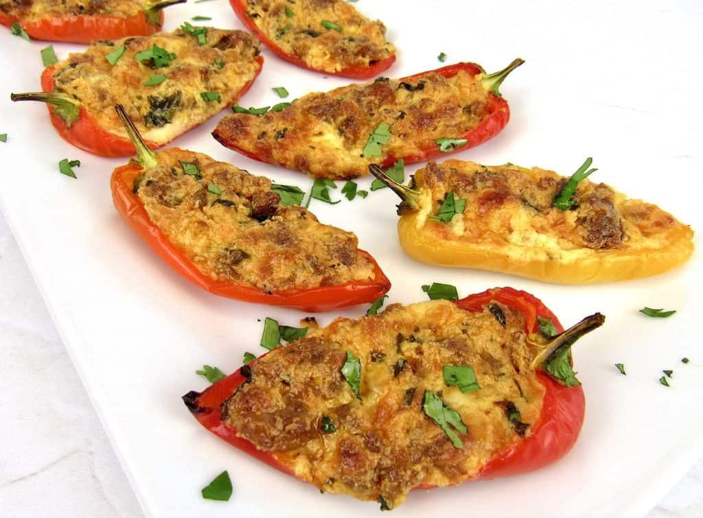 chorizo and cheese stuffed mini peppers on white plate